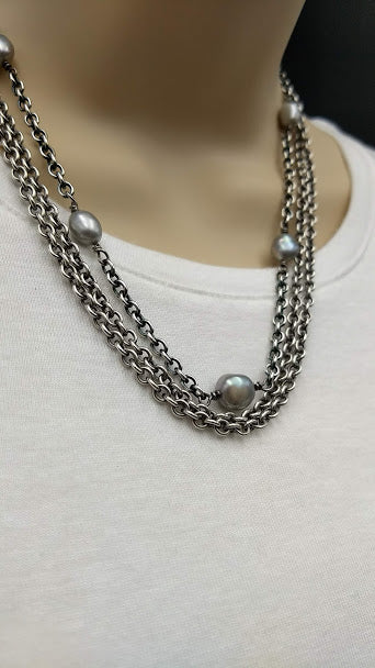Two necklaces in one, sterling silver and gray pearls