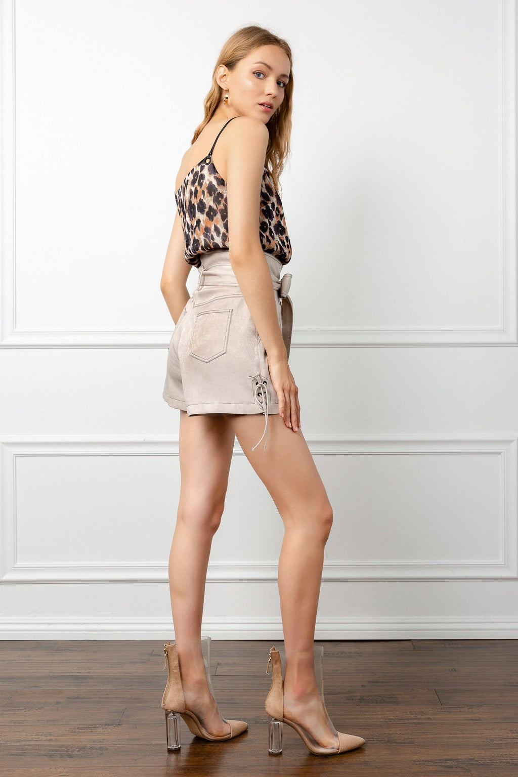 blonde model full body shot wearing beige shorts and leopard pattern tank top by j.ing