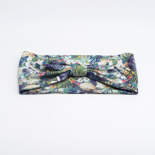 Painterly floral athletic headband for sport with top knot. Able to be worn in multiple ways. Designed in Blue Mountains, Australia. Soft, sweat wicking material.
