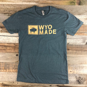 WyoMade Logo Tee | Unisex  The reinvented WyoMade Apparel Logo is a modern twist on our long time iconic design from WyoMade Apparel!   The Bison represents freedom and is a staple of Wyoming's open spaces. This Indigo colored T-shirt is sure to appease your desire to roam free.  Be a part of the herd in a comfy WyoMade Logo T-Shirt deigned for both men and women.  Offering sizes ranging from:  X-Small Small Medium Large Extra Large - XL Double Extra Large - XXL
