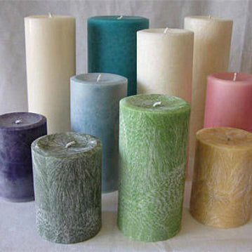 Collection of candles in different sizes and colors