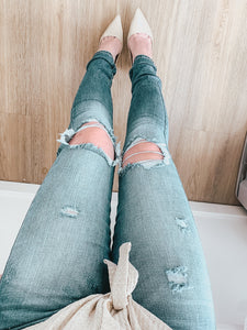 Molly High Rise Busted Knee Jeans