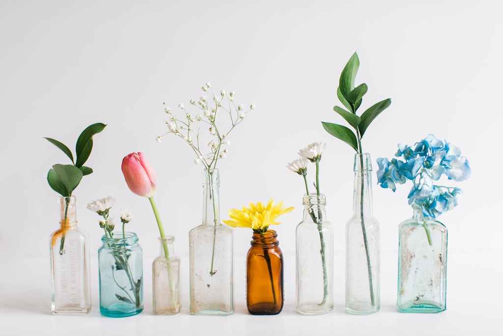 Sprigs of flowers in little vases depicting variety in a memoir writing group with Brenda Smit-James