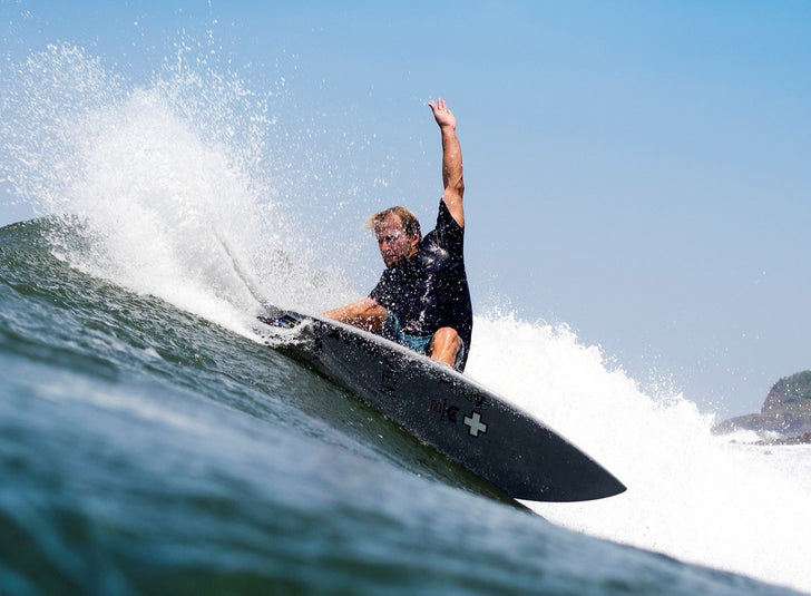 Josh Kerr surfing a surf prescriptions surfboard with varial surf technlogy.