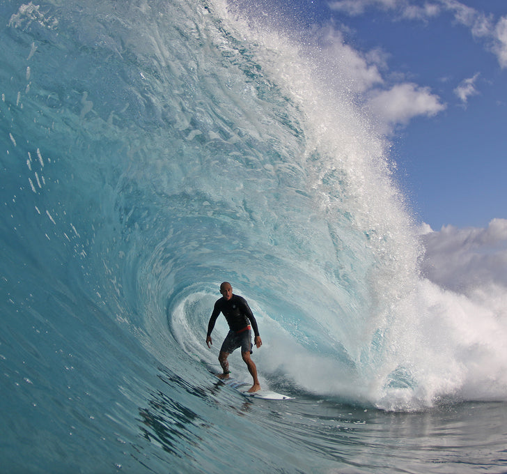 Shane Dorian on his JC Hawaii surfboard constructed with a Varial surf technology foam surfboard blank.