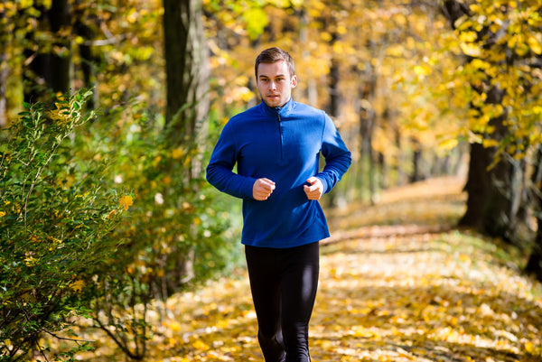 Man running illustrates some of the benefits of probiotics. They help with digestion and assimilation, regular bowel movements. They strengthen the immune system and fight pathogenic bacteria, viruses and yeast.