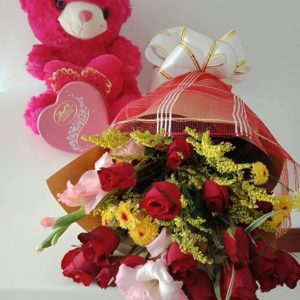12 red roses with fillers in a bouquet and 8″ inches heartshape bear and lindt heartshape