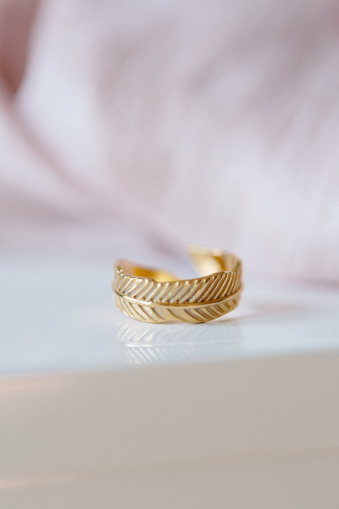 Up close image of the gold Feather Ring.