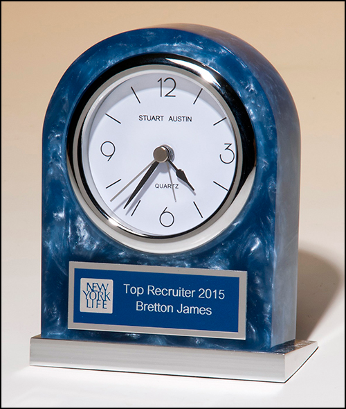 Airflyte Blue swirl Acrylic clock with polished silver aluminum base. Silver bezel, white dial, three-hand movement