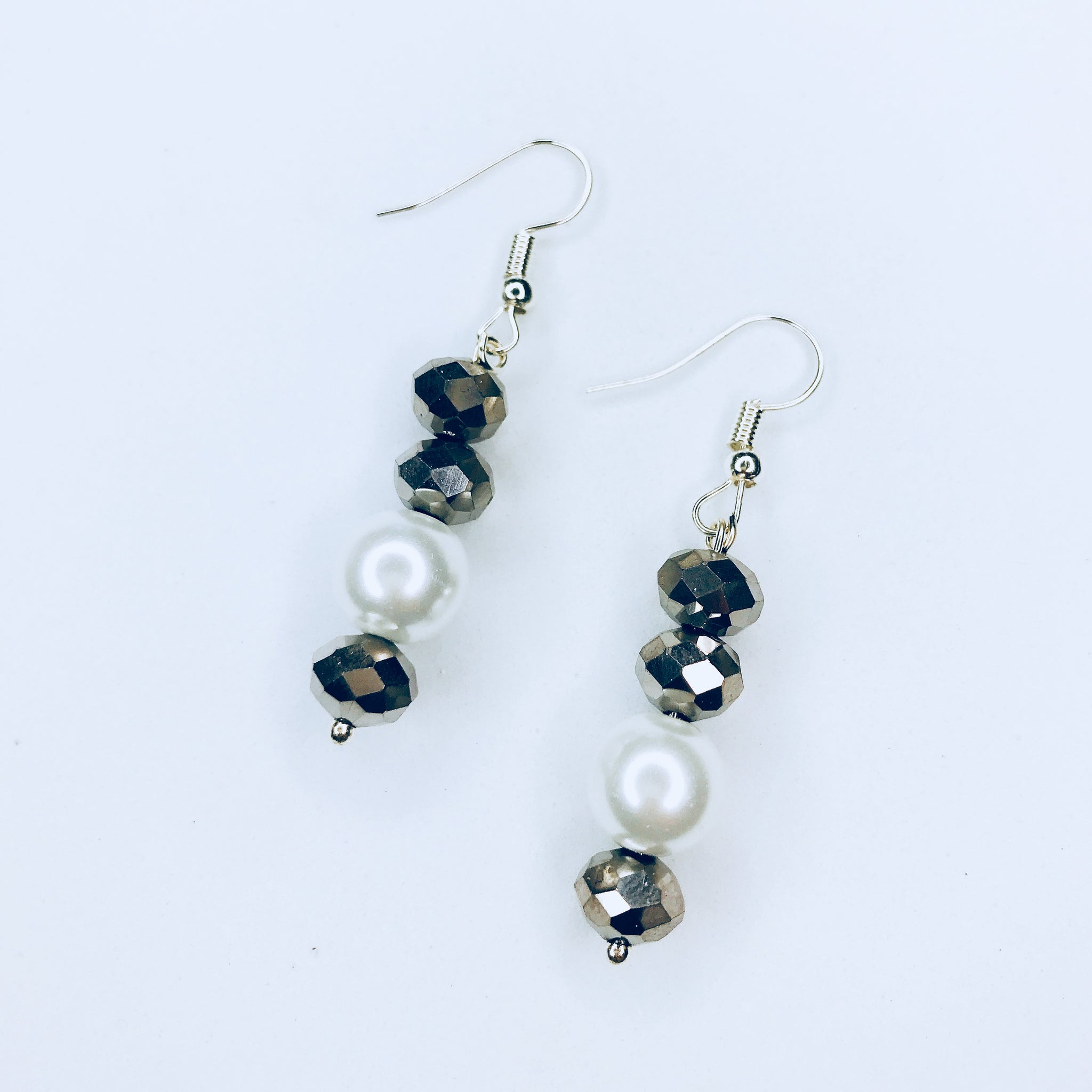Jane - chic silver and white bead earrings.