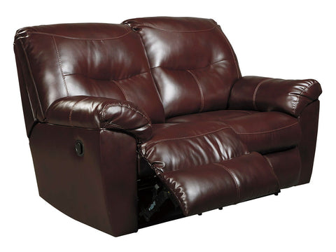 Shop Ashley Furniture Kilzer Mahogany Reclining Loveseat   Mahongany at Mealey's Furniture