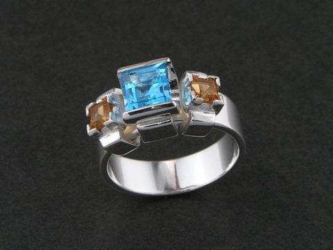 Blue topaz and citrine ring