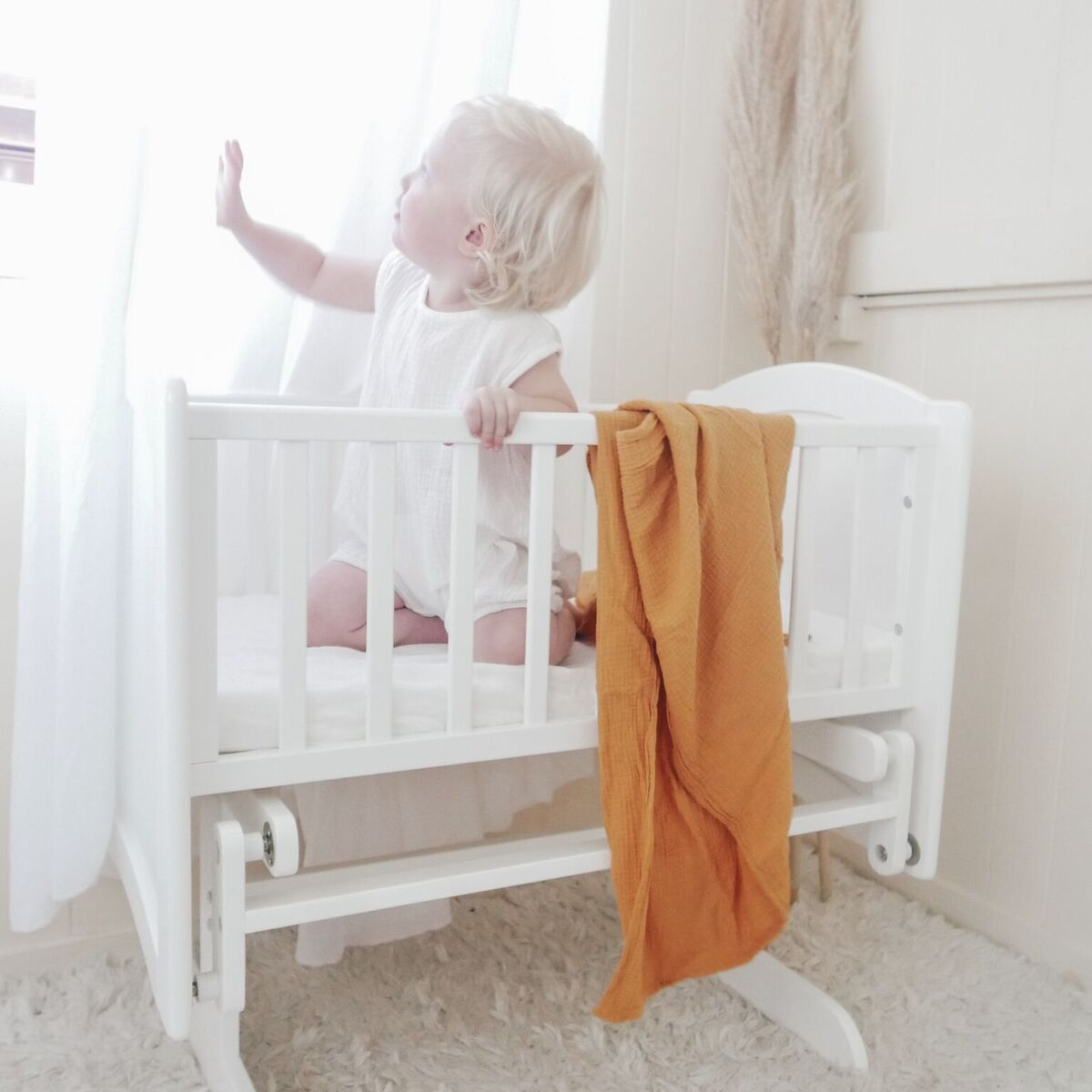 Rocking Cradle with Toddler Demonstrating Strength