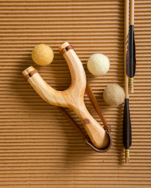 slingshot catapult wooden toy handmade felt ball vegetable dyed waldorf toy open ended toy natural materials toys for boys