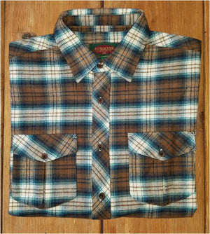 A folded Flyshacker flannel shirt, camel and turquoise
