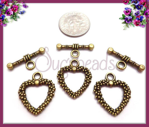 4 Antiqued Brass Dotted Heart Toggles