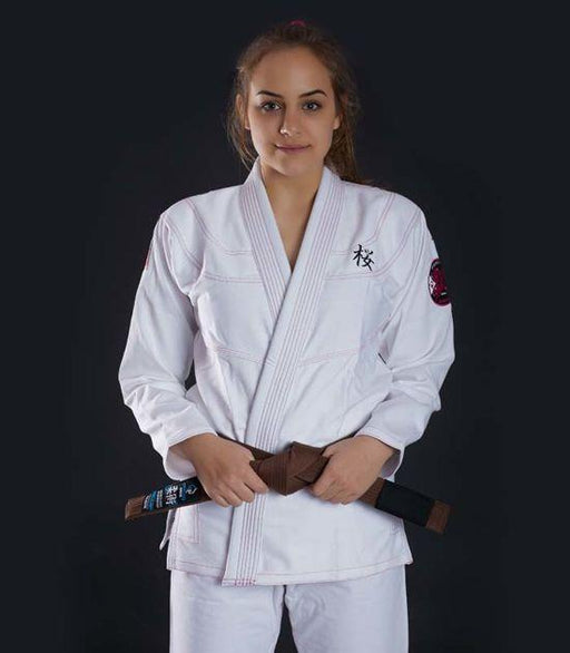 Front view of a Ground Game Sakura BJJ Women`s Gi White