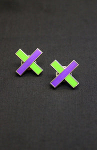 A pair of PROCESSIONS Pin Badges