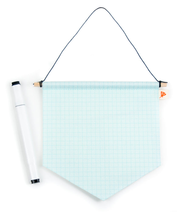 a small banner style pennant with a graph paper pattern printed on the front, and a white marker pictured next to it