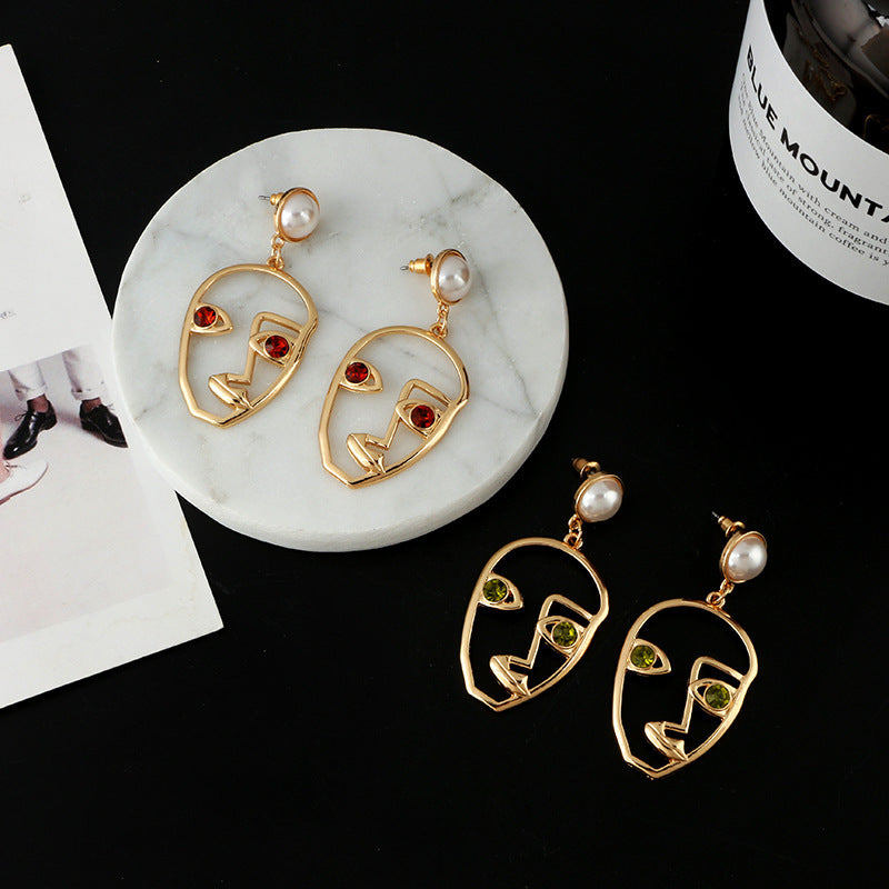 FACES ABSTRACT GOLD EARRINGS