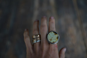 Solar System Ring. 9. Circular cut of Turquoise + Reclaimed sterling silver.  Gold filled Phases of the moon adorn the bezel.