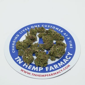 Terpene rich hemp flower buds arranged on top of TN Hemp Farmacy logo. Lab tested and well below 0.3% ∆9-THC.