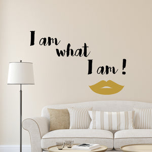 What I Am Wall Quote-With a pair of gold lips and the quote, I am what I am! this fierce wall quote has a confident attitude.  the quote is written in black. hung over sofa