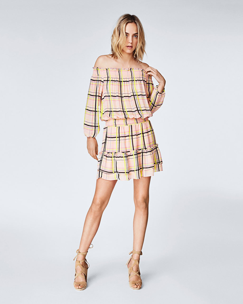 BO10143 - ELECTRIC PLAID SMOCKED DRESS - dresses - short - A little flounce for your step. This light silk, off-the-shoulder dress features a smocked silhouette and ruffled hem. The vibrance of the plaid print adds a little more pizzazz. Final Sale