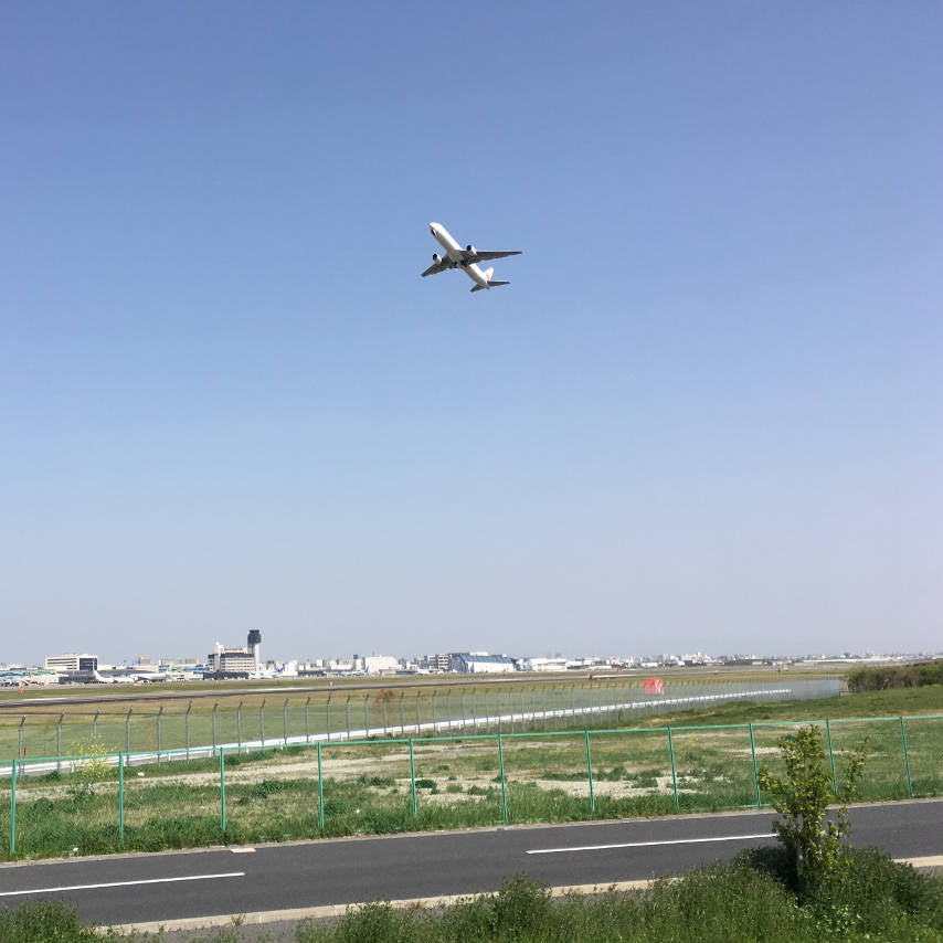 A plane taking off at Itami airport on Minoh cycling route.