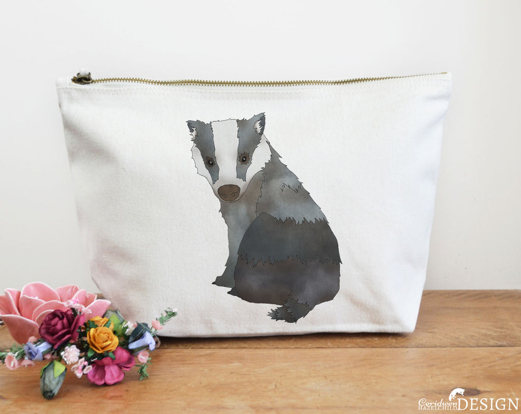 A canvas zip-up wash bag with a badger illustration by Ceridwen Hazelchild Design.