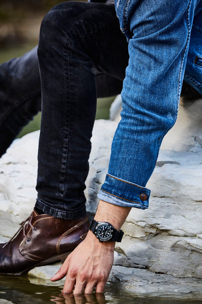 a hipster style man wearing the all black men's diving watch
