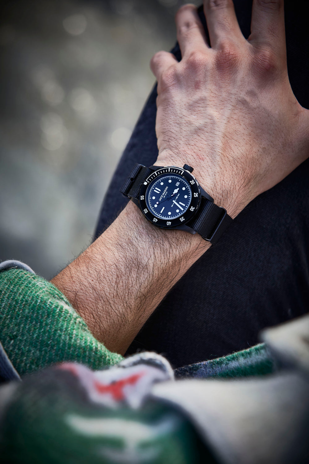 a man wearing the all black 42mm diver watch
