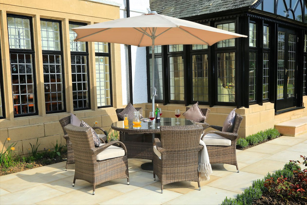 Bellevue outdoor patio dining set by Mr. backyard includes 7 to 8 pieces and is made with rattan and aluminum frame.