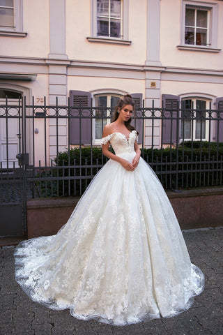 Floral embroidery wraps the fitted sweetheart bodice before trailing down the wonderfully full and dreamy skirt of this fit-for-a-princess ballgown.