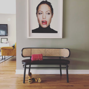 angelina jolie portrait with black hk living usa cane webbing bench and pink chanel bag