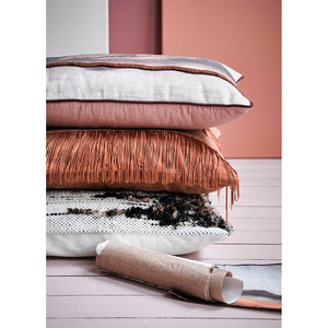 stack of throw pillows with texture in pastel colors