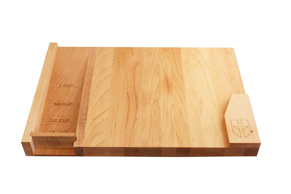 left handed wooded cutting board with measuring chute
