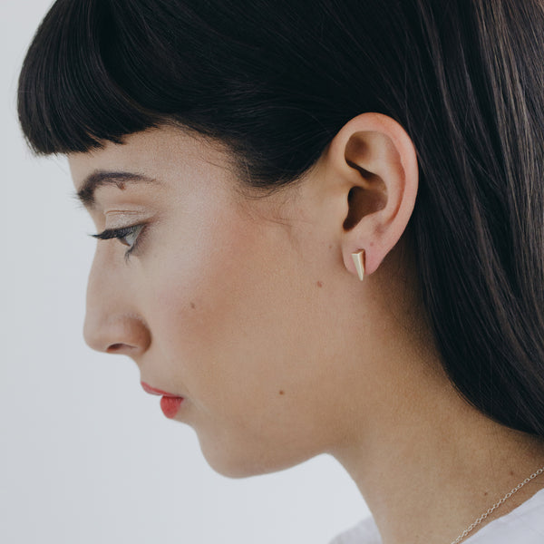 TESSON post earrings in bronze on model from MGG Studio