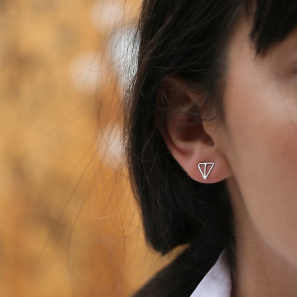 VELOS silver post earrings by MGG Studio on model