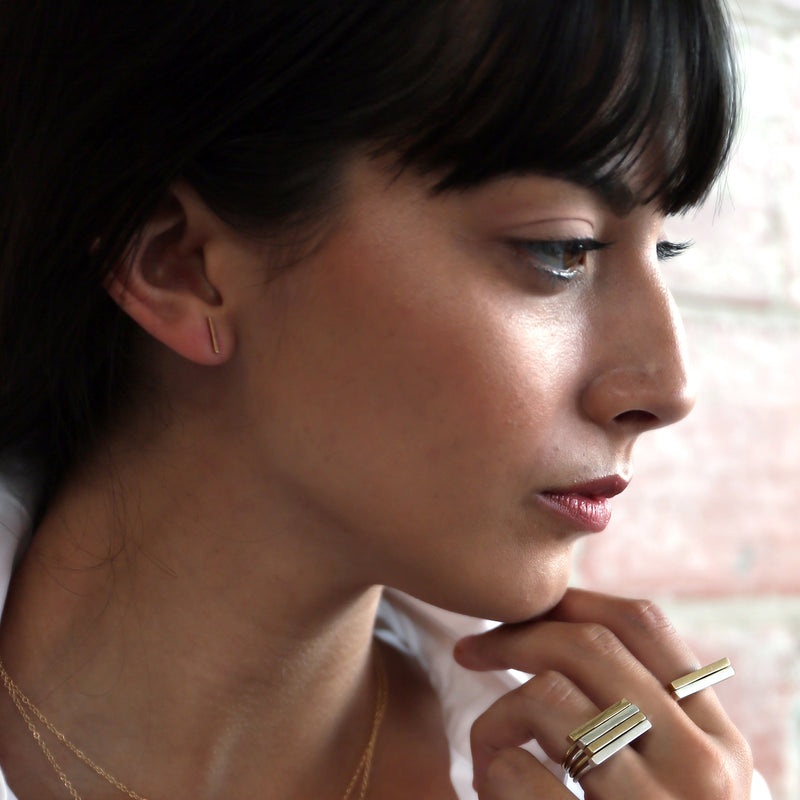 VIGA 14k gold bar studs from MGG Studio on model