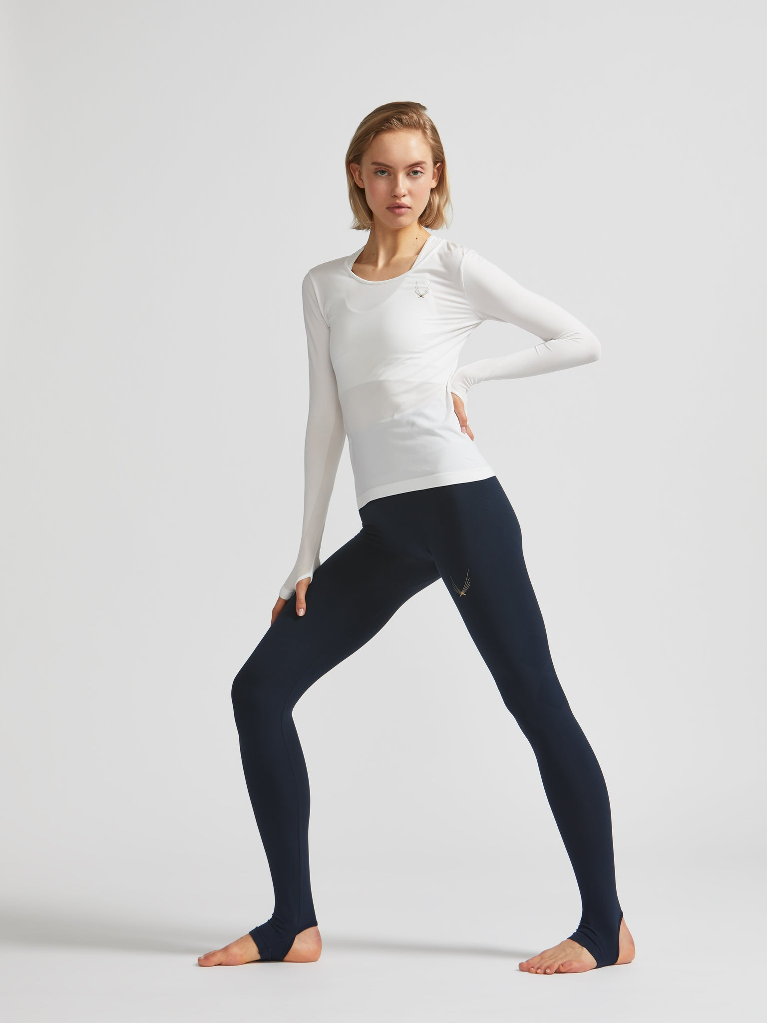 lucas hugh technical knit long sleeve top in white made from quick drying fabric, ventilation panels and thumb holes. Ideal for running, yoga or pilates