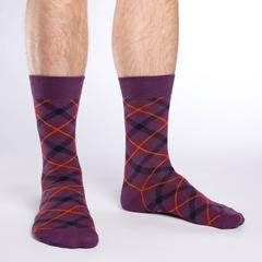 Men's feet in purple geometric socks