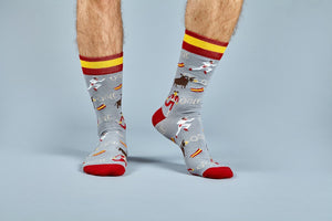Men's feet in gray San Fermin festival socks