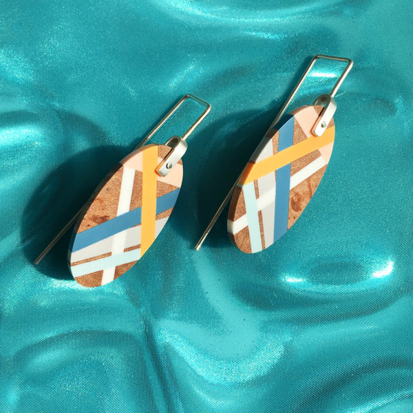 Laura Jaklitsch Jewelry Wood x Polyurethane Marina Earrings in blue, peach, yellow, and grey