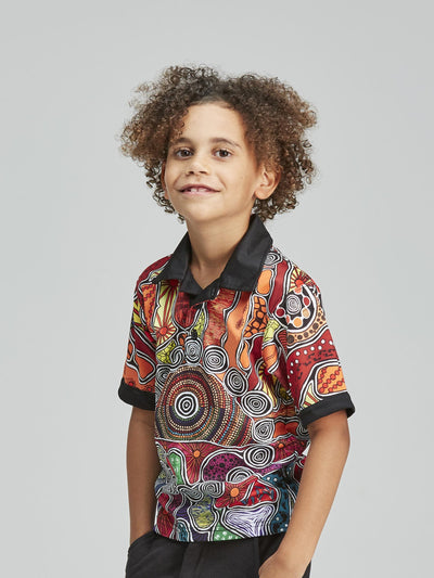 Colourful patterned kid's polo shirt, featuring an authentic Indigenous Australian design.