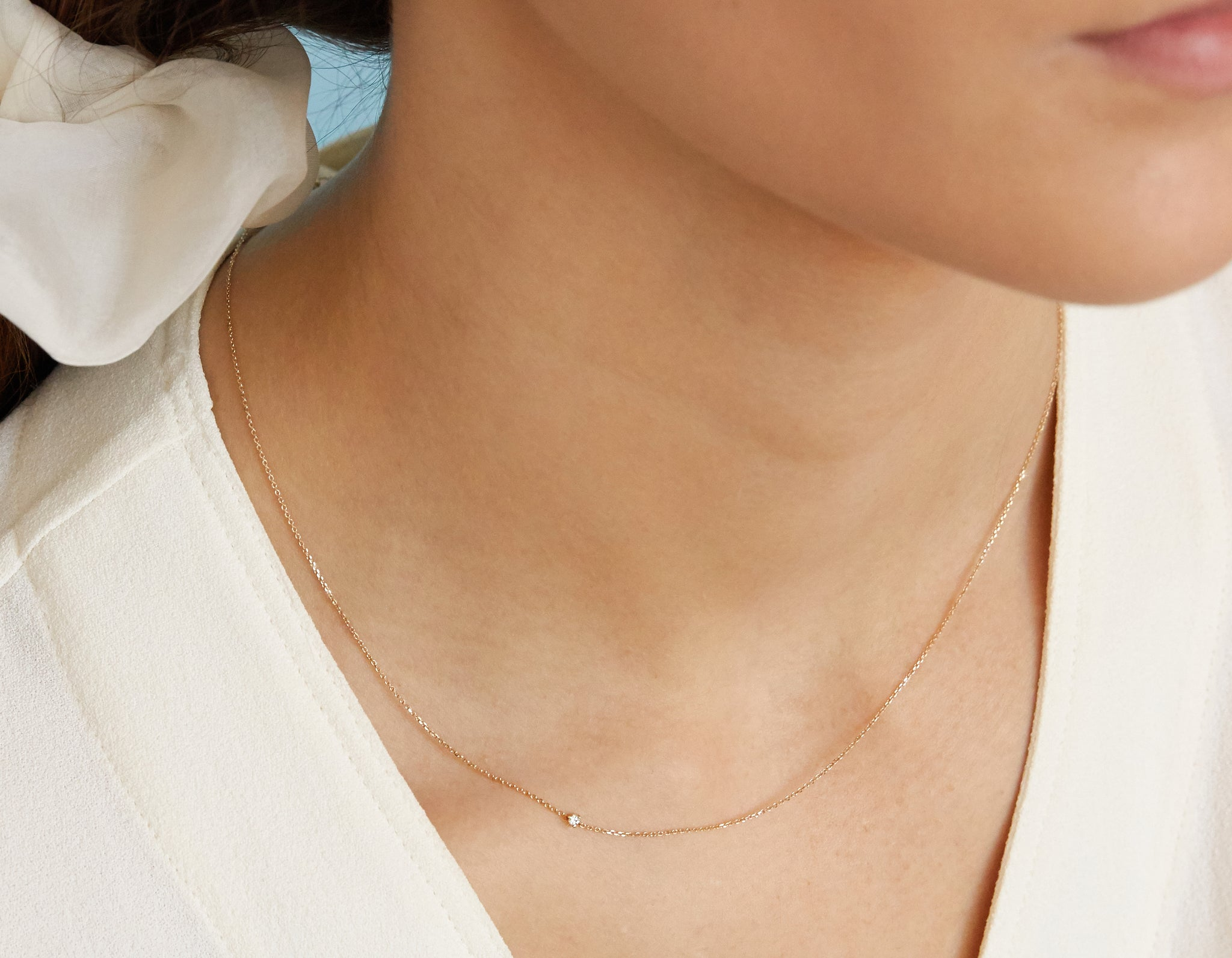 Woman modeling simple Tiny diamond Necklace 14k solid gold