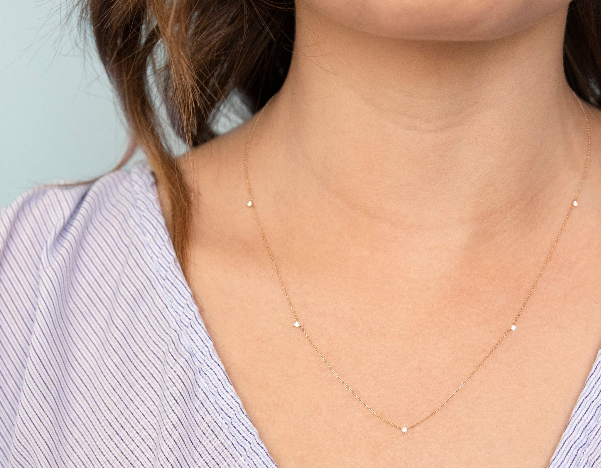 Woman modeling Tiny Diamond Station Necklace simple modern