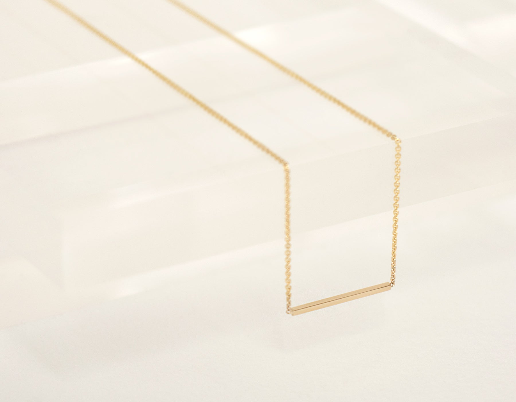 Dangling close up on 14k solid yellow gold Line Necklace geometric minimalist thin chain Vrai & Oro