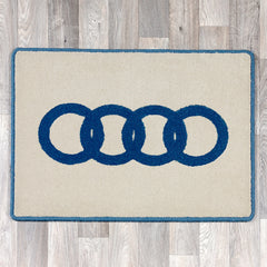 Rectangular rug with Audi logo in blue and cream colours