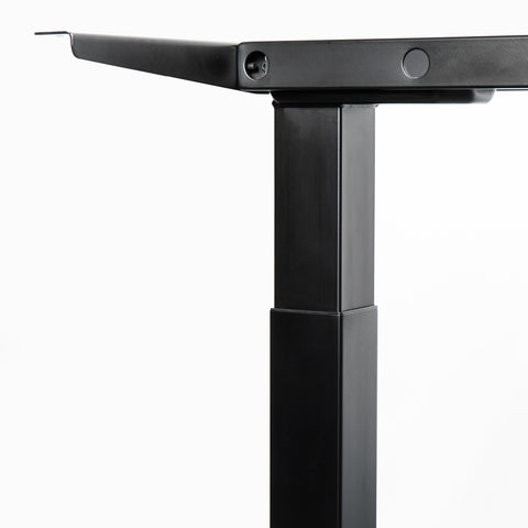 Close up of a black desk frame leg that can expand automatically